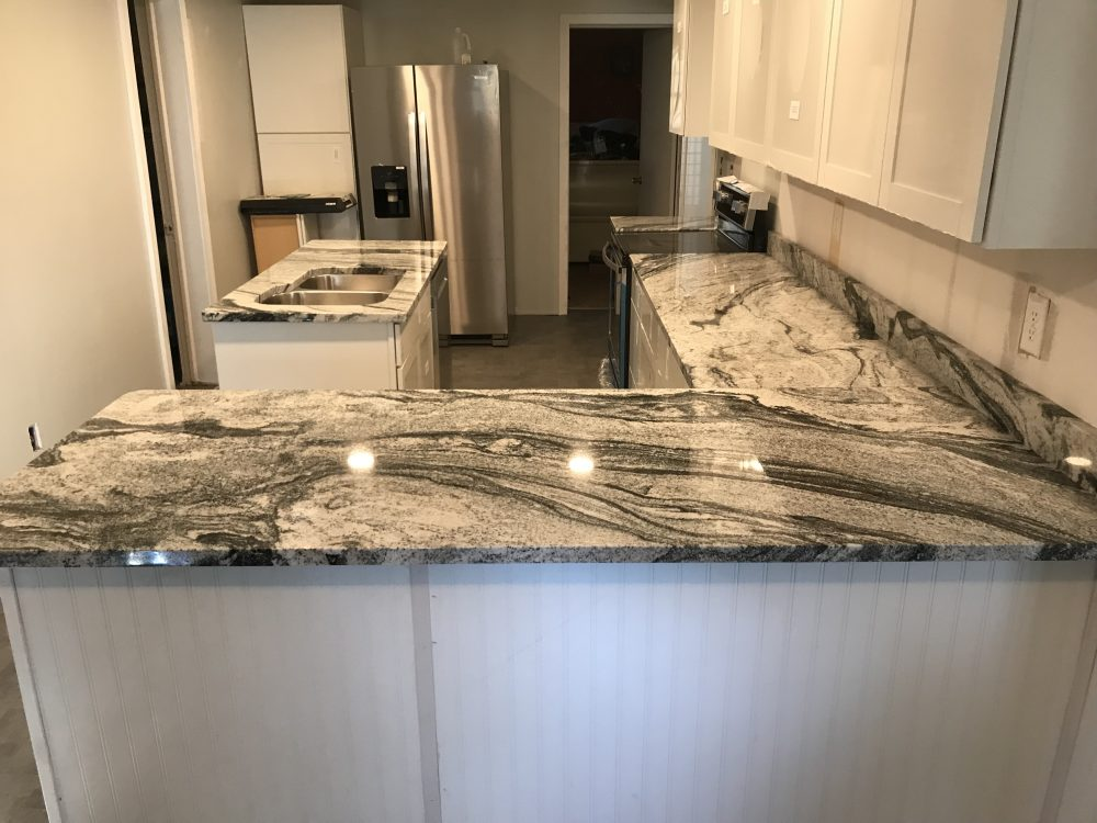 Granite - Viscon White with a 60-40 SS Undermount Sink